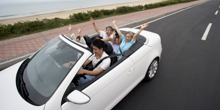 Happy Family Driving in a Convertible